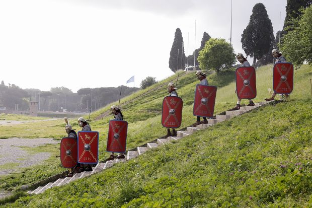 Members of the Gruppo Storico Romano (Roman Historical Group) dressed as centurions arrive at Circus Maximus as they mark the 2769th anniversary of the founding of Rome, Italy, April 24, 2016. REUTERS/Alessandro Bianchi