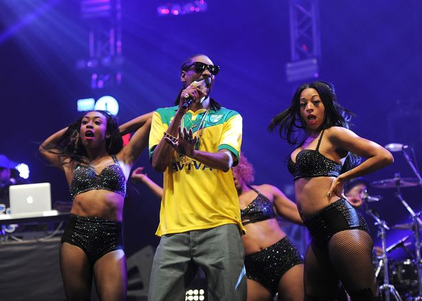 Snoop-Dogg-performs-on-stage-wearing-a-Norwich-City-FC-football-shirt